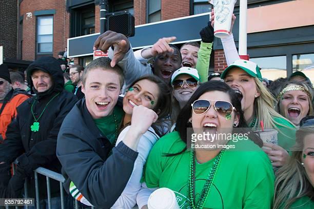 Enthusiastic crowd St Patricks Day Parade South Boston Massachusetts