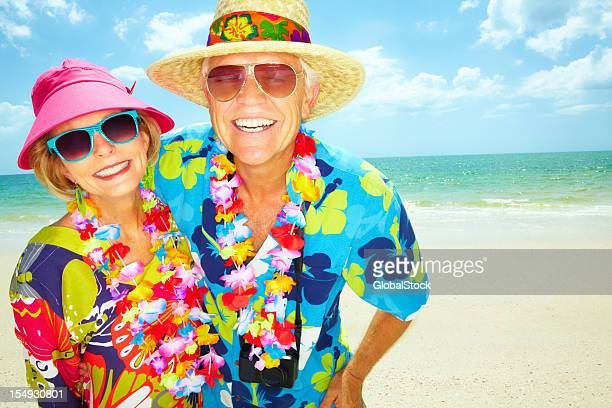 Enthusiastic retired couple enjoying their vacation