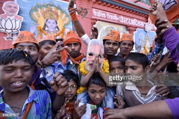 Enthusiastic supporters at PM Modi's road show on March 5 2017 in Varanasi India After grand response from the residents of Varanasi yesterday Prime...