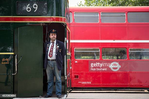 Enthusiasts attend a gathering of Routemasters at Finsbury Park to celebrate the 60th Anniversary of the Routemaster bus on July 12 2014 in London...