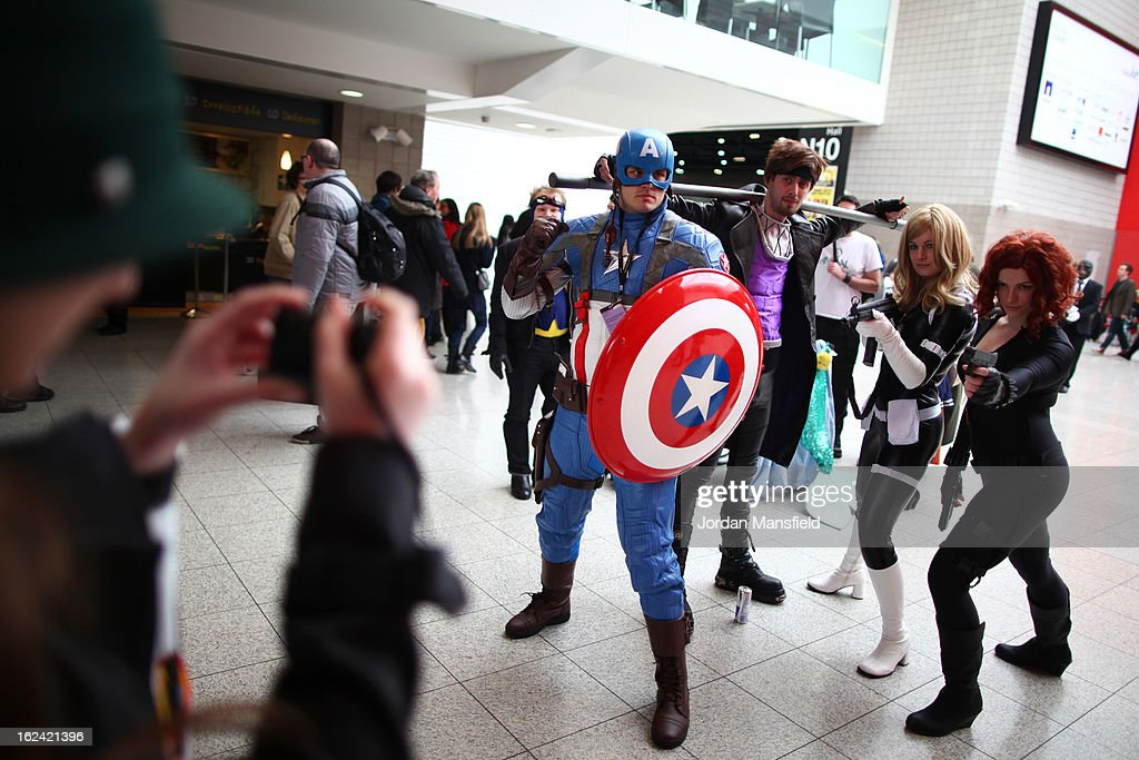 Enthusiasts in costume pose for a photo at the London Super Comic Convention at the ExCeL Centre on February 23, 2013 in London, England. Enthusiasts at the Comic Convention are encouraged to wear a costume of their favourite comic character and flock to the ExCeL to gather all the latest news in the world of comics, manga, anime, film, cosplay, games and cult fiction.