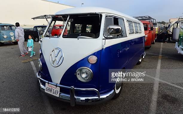 Enthusiasts look over iconic Volkswagen buses displayed at 'Das OCTO Fest 2013' a swap and display gathering for enthusiasts and owners of 1967 and...