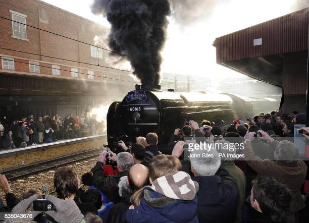Enthusiasts pack the platforms of York Station as the Peppercorn class A1 60163 Tornado leaves the station