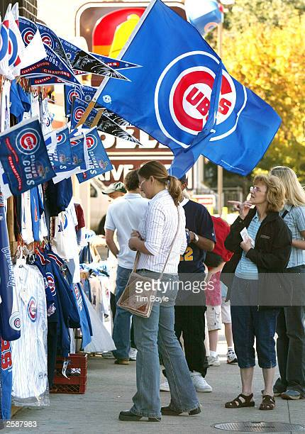 Enthusiasts shop for Chicago Cubs merchandise near Wrigley Field October 13 2003 Chicago Illinois The Cubs are one win away from playing in their...