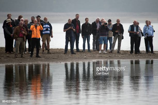 Enthusiasts wait for the restored Blue Bird K3 hydroplane powerboat to undertake a test run at Bewl Water on September 26 2017 near Maidstone England...