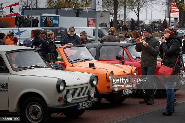 Enthusiats look of the East Germany produced car Trabanton near Boesebruecke bridge in Bornholmer Strasse where 25 years before thousands of East...