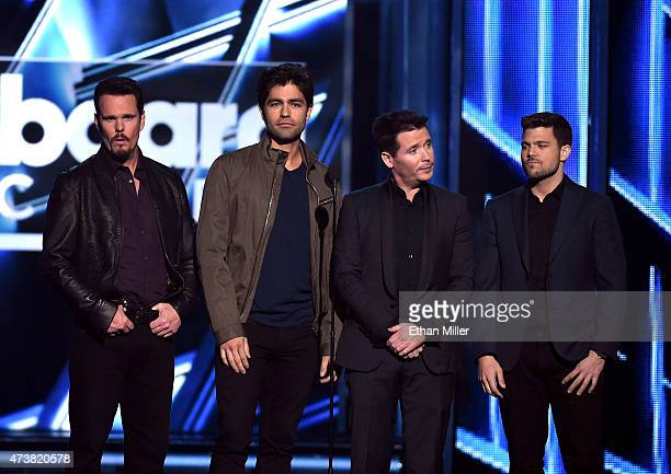 'Entourage' movie cast members Kevin Dillon Adrian Grenier Kevin Connolly and Jerry Ferrara present the Top Artist award during the 2015 Billboard...