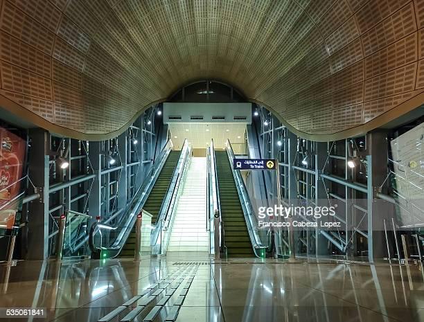 Entrance and escalators in a Dubai Metro station UAE