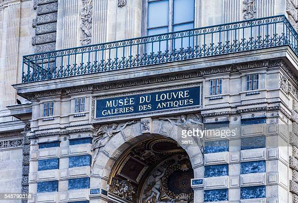 Entrance and sign of the Louvre Museum, Paris