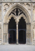 Entrance doorway to west tower of Ely cathedral Cambridgeshire England