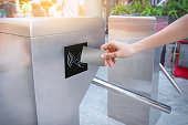 Woman use card for touch of entrance gate card access Security system.