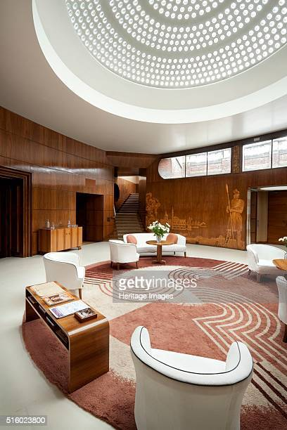 Entrance hall of Eltham Palace Greenwich London 2010 Interior view showing the glass domed roof Engstromer furniture and Dorn rug Eltham was a royal...