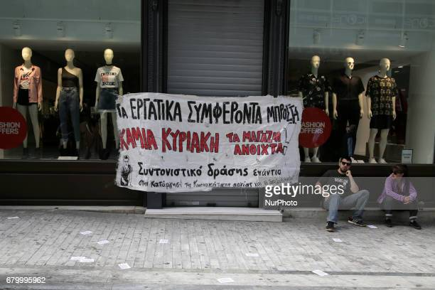 Entrance of an HampM store with banner against work on Sundays in central Athens Greece on Sunday May 7 2017 In the new agreement between the Greek...