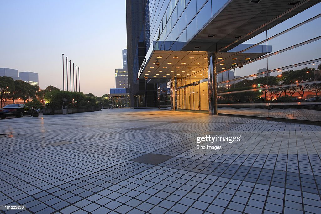 Entrance to an office building at dusk