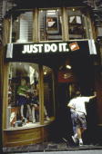 Entrance to Nike store w slogan just do it in English over door