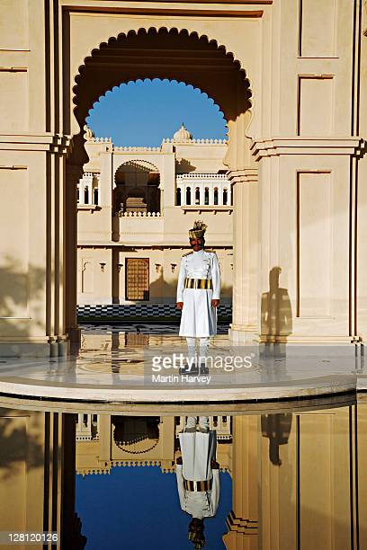 Entrance to the exclusive Udaivil??s Oberoi Hotel. Doorman in crisp white uniform welcoming guests. Udaipur. India. This hotel has been voted the 3rd best hotel in the world by Travel and Leisure Magazine.