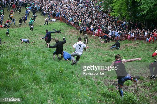 Entrants chasing the cheese at the 2015 'Cheese Rolling'