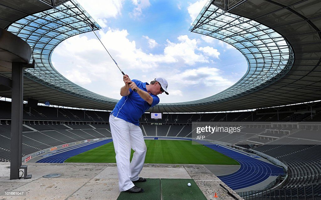 Entrepreneur and chairman of the association 'Made in Berlin e.V.' Joachim Spitzley plays a golf shot at Berlin's Olympic Stadium on June 6, 2010. Playing golf at the stadium, which is normally used for football or athletics, was sold in an auction during a charity dinner. The benefit of the action is aimed for cardiac children.