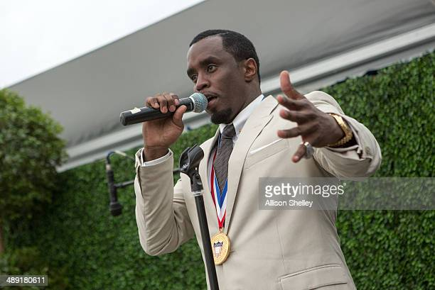 Entrepreneur and philanthropist Sean 'Diddy' Combs addresses a private party at the Newsuem after being honored at Howard University's 146th...