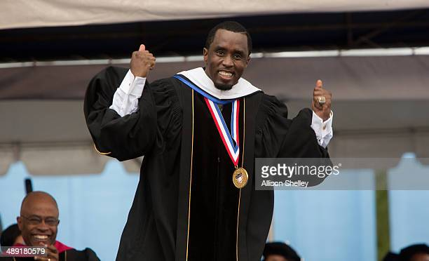 Entrepreneur and philanthropist Sean 'Diddy' Combs reacts after delivering the commencement speech at Howard University's 146th commencement...