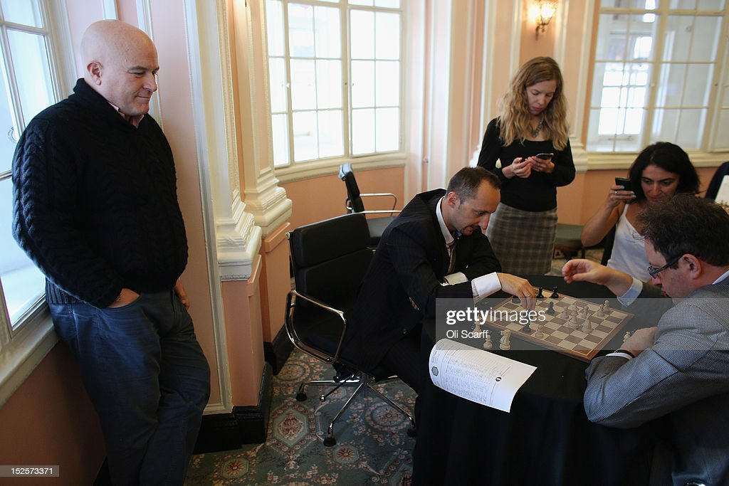 Entrepreneur Andrew Paulson (L) watches chess Grandmasters <a gi-track='captionPersonalityLinkClicked' href=/galleries/search?phrase=Boris+Gelfand&family=editorial&specificpeople=790712 ng-click='$event.stopPropagation()'>Boris Gelfand</a> (R) and <a gi-track='captionPersonalityLinkClicked' href=/galleries/search?phrase=Veselin+Topalov&family=editorial&specificpeople=2093743 ng-click='$event.stopPropagation()'>Veselin Topalov</a> (C) analyse their match immediately after its conclusion at the World Chess London Grand Prix at Simpson's-in-the-Strand on September 22, 2012 in London, England. The event, which begins the 2012/13 World Chess Championship Cycle, runs until October 3, 2012 and takes place over 11 rounds. The London Grand Prix is the first tournament in an ambitious, high-profile rebranding of world chess by American-born entrepreneur Andrew Paulson whose intention is to regain the global popularity chess enjoyed in the 1970s with matches between American Bobby Fischer and the Soviet Union's Boris Spassky.