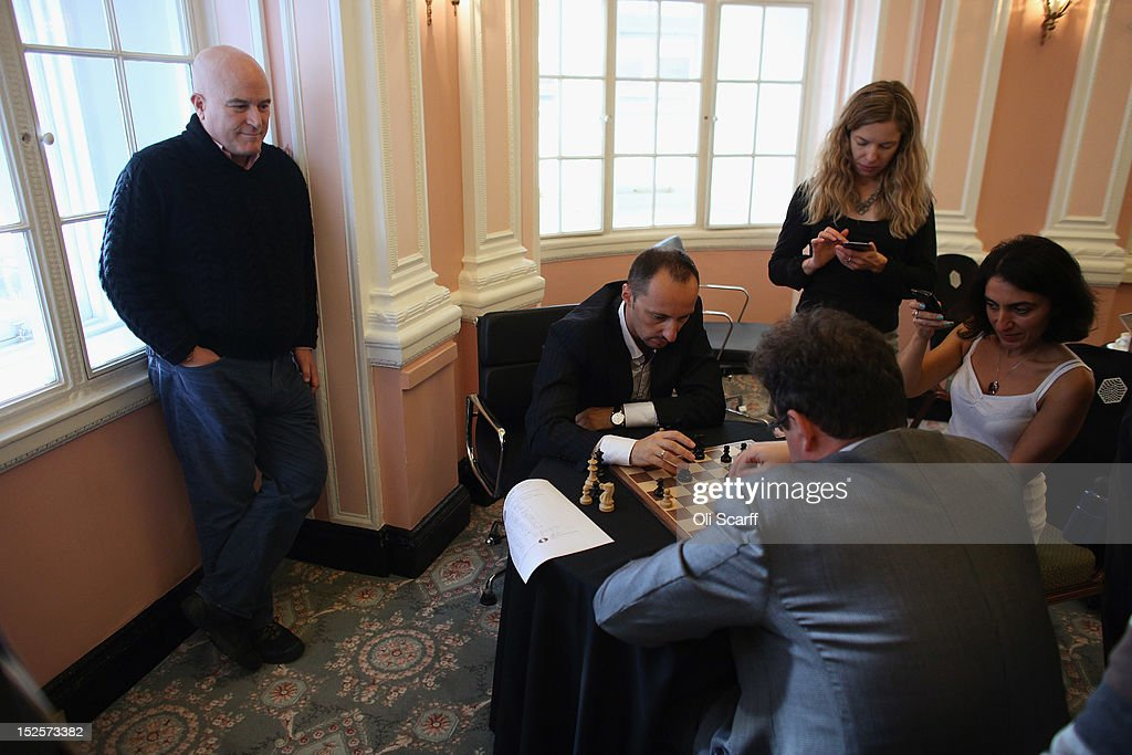 Entrepreneur Andrew Paulson (L) watches chess Grandmasters <a gi-track='captionPersonalityLinkClicked' href=/galleries/search?phrase=Boris+Gelfand&family=editorial&specificpeople=790712 ng-click='$event.stopPropagation()'>Boris Gelfand</a> (3rd R) and <a gi-track='captionPersonalityLinkClicked' href=/galleries/search?phrase=Veselin+Topalov&family=editorial&specificpeople=2093743 ng-click='$event.stopPropagation()'>Veselin Topalov</a> (C) analyse their match immediately after its conclusion at the World Chess London Grand Prix at Simpson's-in-the-Strand on September 22, 2012 in London, England. The event, which begins the 2012/13 World Chess Championship Cycle, runs until October 3, 2012 and takes place over 11 rounds. The London Grand Prix is the first tournament in an ambitious, high-profile rebranding of world chess by American-born entrepreneur Andrew Paulson whose intention is to regain the global popularity chess enjoyed in the 1970s with matches between American Bobby Fischer and the Soviet Union's Boris Spassky.