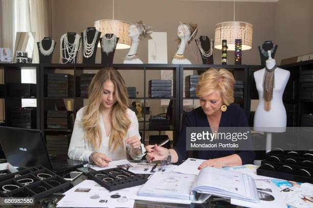 Entrepreneur Anna Maria Ferrari Tanca founder of the brand AnnaBiblo' with her daughter Federica Campari Mother and daughter working on the jeweller...