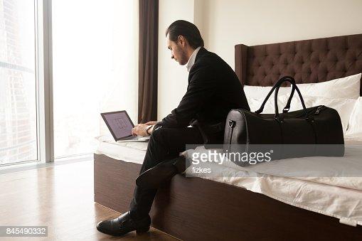 Entrepreneur checks presentation in hotel room : Stock Photo