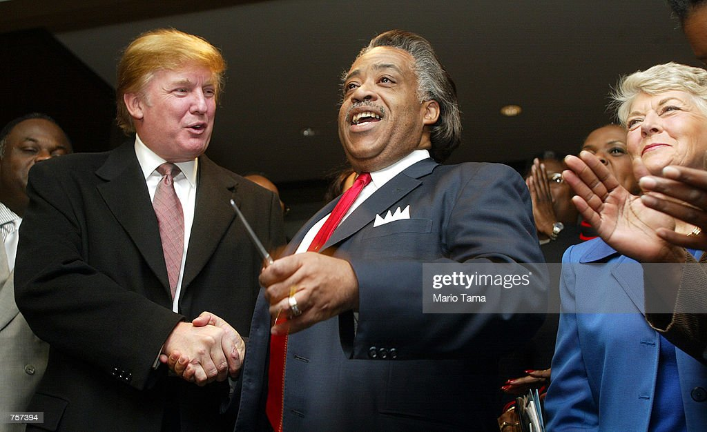 Entrepreneur Donald Trump (L) shakes hands with Rev. Al Sharpton (C) as Geraldine Ferraro (R) attends a ribbon cutting ceremony for Sharpton's National Action Network Convention April 5, 2002 in New York City. The group aims to further the development of civil rights.