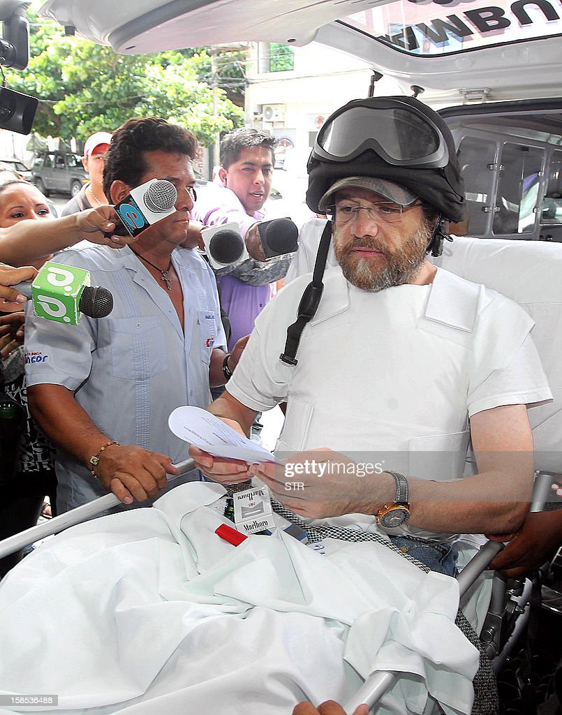 OUT --- US entrepreneur Jacob Ostreicher is carried on a stretcher while exiting a court hearing where the judge granted his liberty in Santa Cruz, Bolivia on December 18, 2012. Ostreicher was detained without charge for 18 months in Palmasola prison, for suspicion of money laundering and criminal organization.