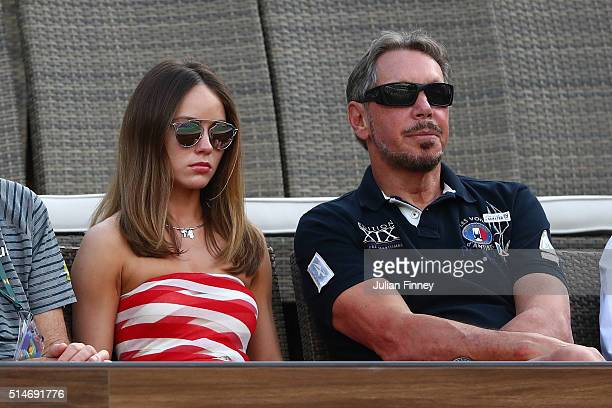 Entrepreneur Larry Ellison with girlfriend Nikita Khan watch on during day four of the BNP Paribas Open at Indian Wells Tennis Garden on March 10...