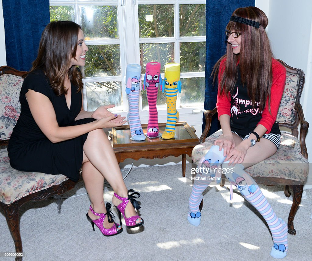 Entrepreneur Olga Kay (L) mentors actress Allisyn Ashley Arm at Portrait Day At The Starving Artists Project on September 21, 2016 in Los Angeles, California.