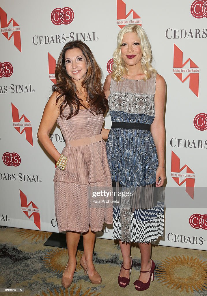Entrepreneur / Philanthropist Lea Porter (L) and Actress Tori Spelling (R) attend the Helping Hand of Los Angeles' 84th annual Mother's Day luncheon at the Beverly Hills Hotel on May 10, 2013 in Beverly Hills, California.