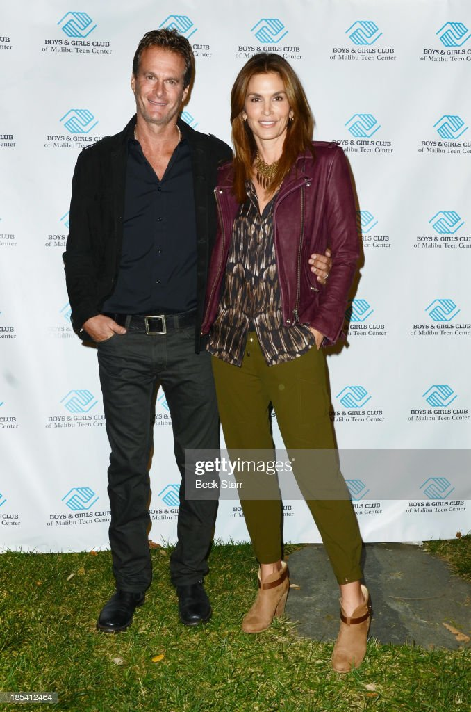 Entrepreneur <a gi-track='captionPersonalityLinkClicked' href=/galleries/search?phrase=Rande+Gerber&family=editorial&specificpeople=549565 ng-click='$event.stopPropagation()'>Rande Gerber</a> and his wife model <a gi-track='captionPersonalityLinkClicked' href=/galleries/search?phrase=Cindy+Crawford&family=editorial&specificpeople=202842 ng-click='$event.stopPropagation()'>Cindy Crawford</a> arrive at the Malibu Boys And Girls Club Fundraiser to introduce the 2013 BGCM Youth of the Year on October 19, 2013 in Malibu, California.