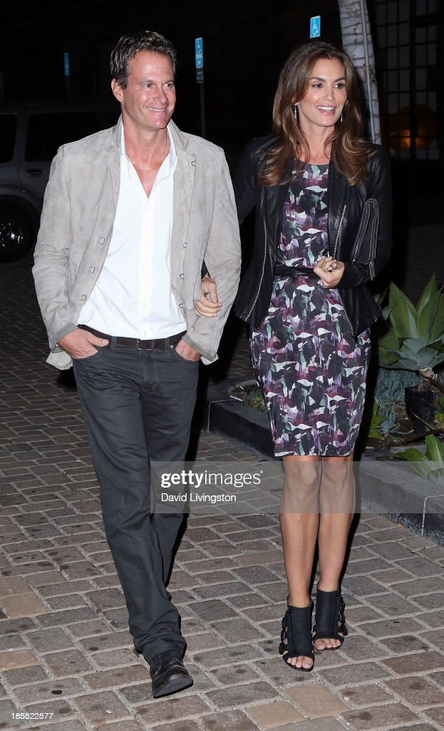 Entrepreneur Rande Gerber (L) and wife model Cindy Crawford attend the launch party for Brian Edwards' book 'Enter Miss Thang' at Cafe Habana on October 21, 2013 in Malibu, California.