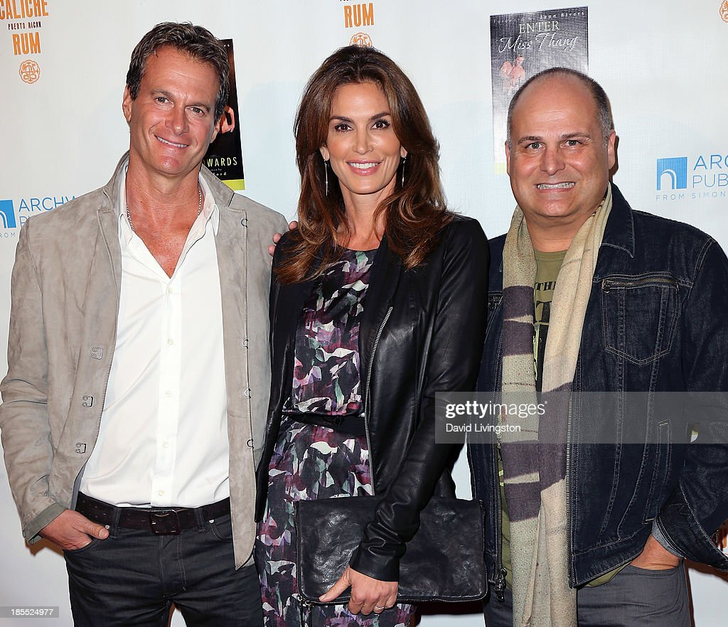 Entrepreneur Rande Gerber, wife model Cindy Crawford and celebrity talent executive/author Brian Edwards attend the launch party for Brian Edwards' book 'Enter Miss Thang' at Cafe Habana on October 21, 2013 in Malibu, California.