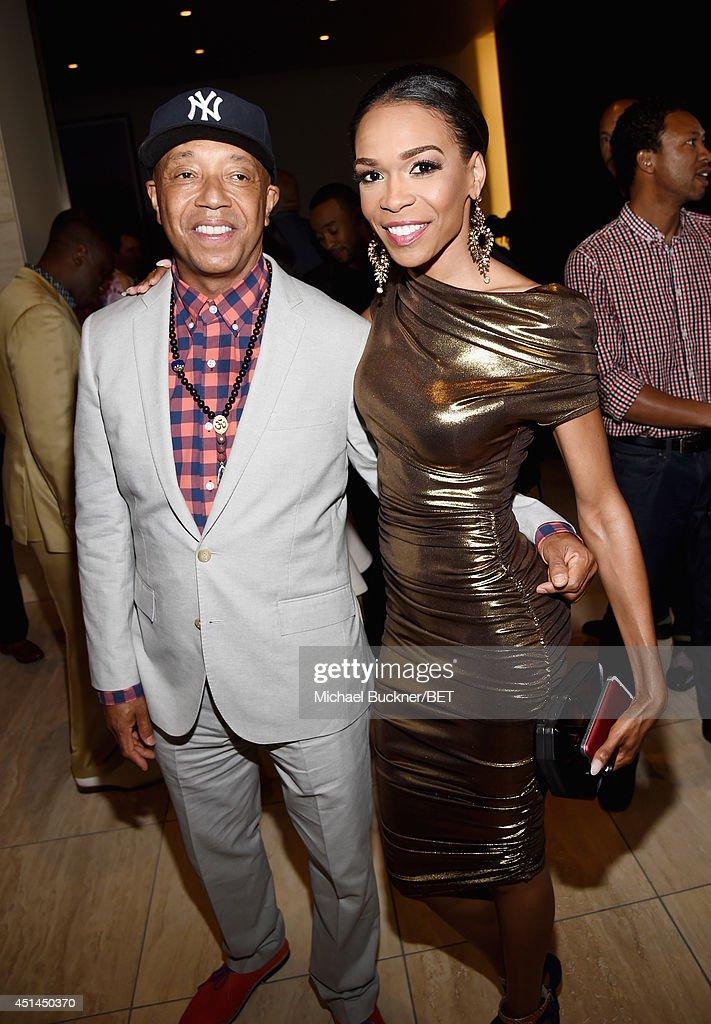 Entrepreneur <a gi-track='captionPersonalityLinkClicked' href=/galleries/search?phrase=Russell+Simmons&family=editorial&specificpeople=202479 ng-click='$event.stopPropagation()'>Russell Simmons</a> and singer Michelle Williams attend the BET AWARDS '14 Debra Lee's Pre-Dinner held at Milk Studios on June 28, 2014 in Los Angeles, California.