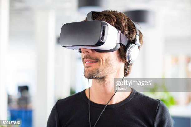 Entrepreneur testing virtual reality simulator headset