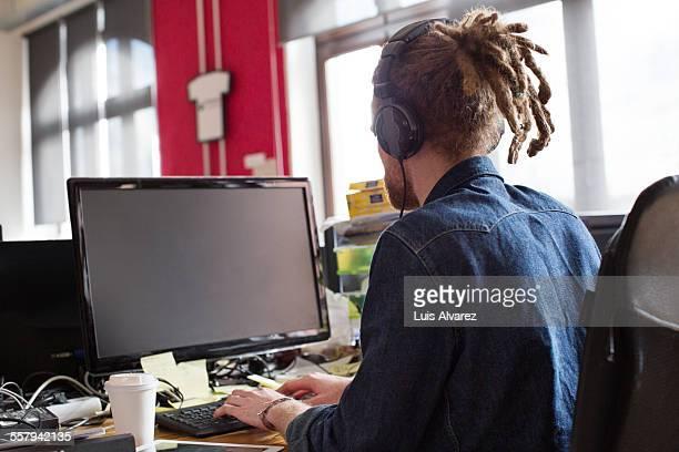 Entrepreneur using desktop PC in start-up office