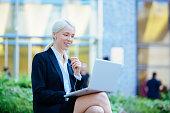 Entrepreneur with Headphones having on-line meeting