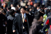 IT entrepreneurs Lei jun leaves the Great Hall of the People after attending the opening ceremony of the National People's Congress on March 5 2014...