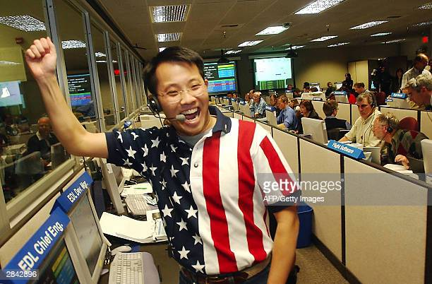 Entry Descent and Landing Chief Engineer Wayne Lee reacts in the control room at NASA's Jet Propulsion Laboratory as they get a signal from the Mars...