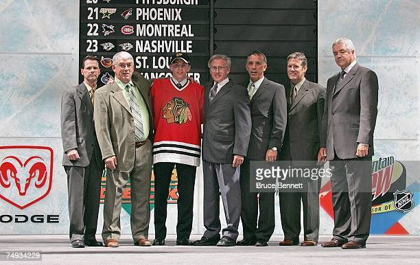 Entry Draft first overall pick Patrick Kane poses for a photo with members of the Chicago Blackhawks staff on the draft stage during the first round...