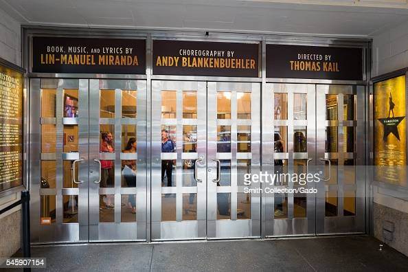 Entryway to the Richard Rodgers theatre with signs for the musical Hamilton New York City New York July 7 2016