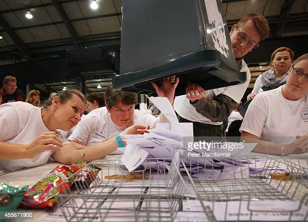 Enumerators look into a ballot box as it is emptied at the count centre for the Scottish referendum on September 18 2014 in Aberdeen Scotland Polls...