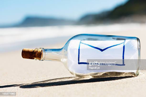 Envelope email icon is message in bottle on empty beach