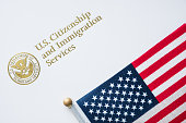 Envelope from U.S. Citizenship and Immigration Services with the American flag on top/U.S. immigration concept