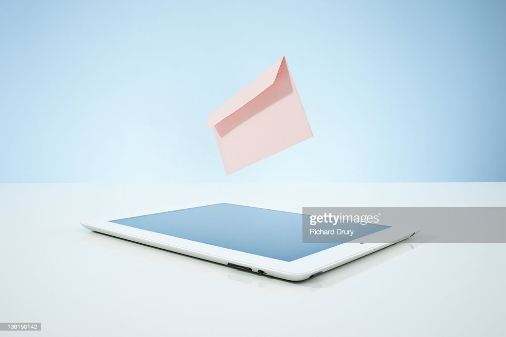 Envelope (email) leaving tablet : Stock Photo