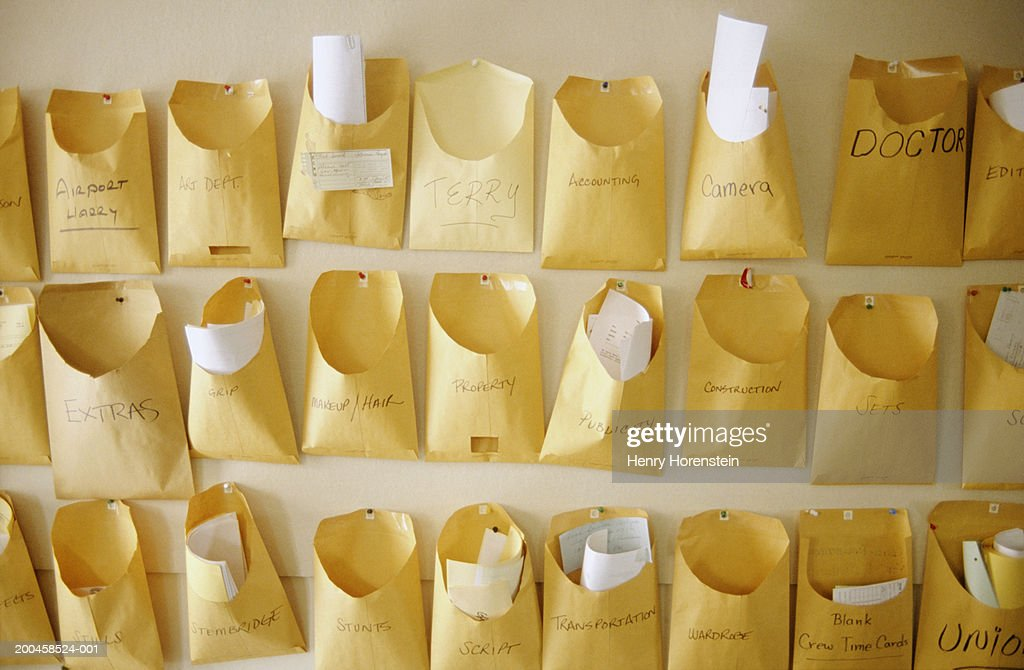 Envelope mailboxes on wall : Stock Photo