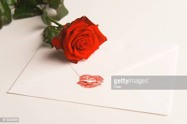 Envelope with lipstick kiss, red rose